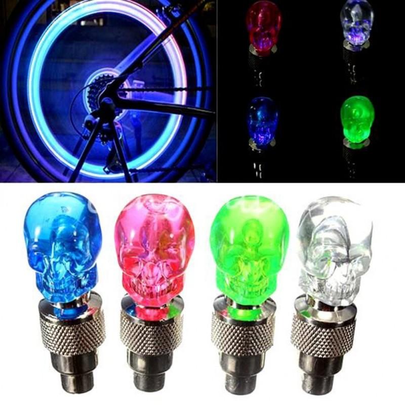 2 pieces - car / motorcycle / bike tire valve caps - neon LED light bulb - skull