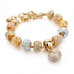 Elegante pulsera de oro con cuentas de cristal y corazón