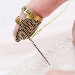 Finger sewing timble -...