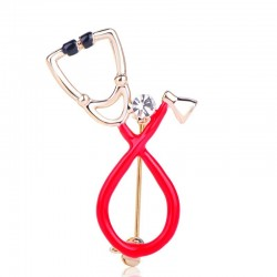 Stethoscope shaped brooch with crystal