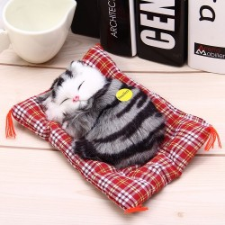Animal de peluche gato con sueno