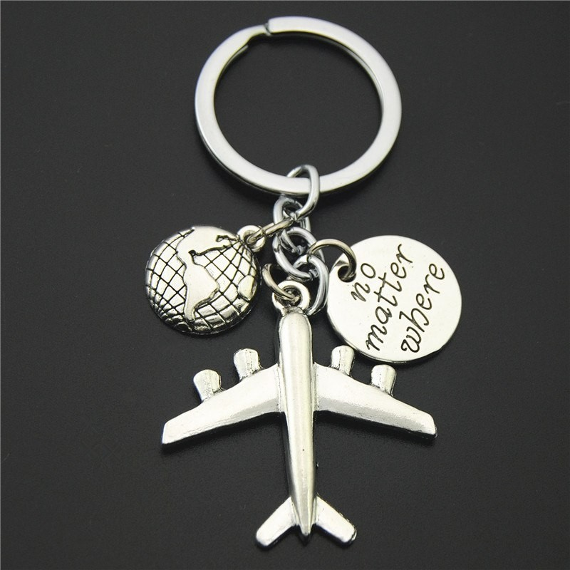 Earth & airplane - silver keychain