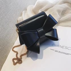 Bolso elegante con nudo y cadena