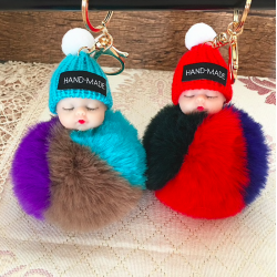 Sleeping baby doll - keychain with fur pompom